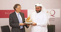 Qatar Charity CEO Yousef bin Ahmed Al Kuwari presents a memento to Co-Chair of Bill and Melinda Gates Foundation, Bill Gates, after signing the agreement at Qatar Charity in Doha